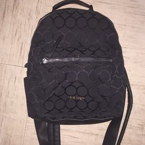 Black mini backpack! In good condition
